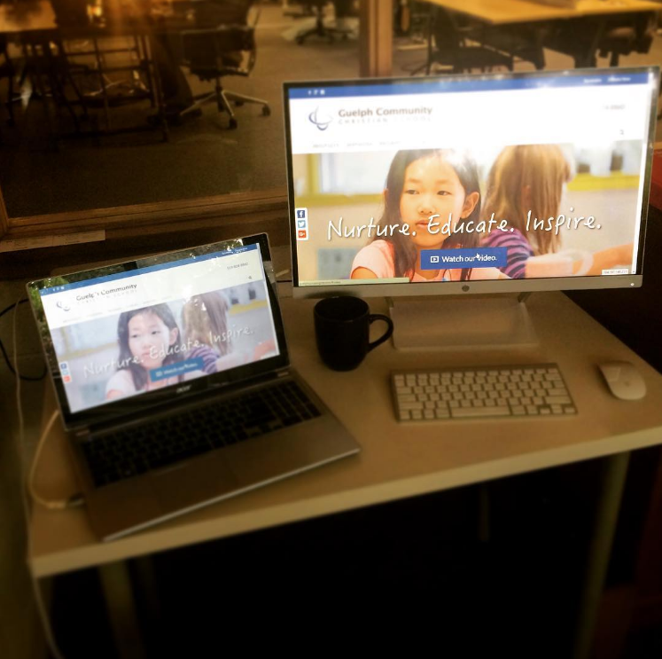 Photo of laptop and computer screen with new GCCS website.